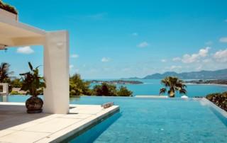 Home pool overlooking coastline