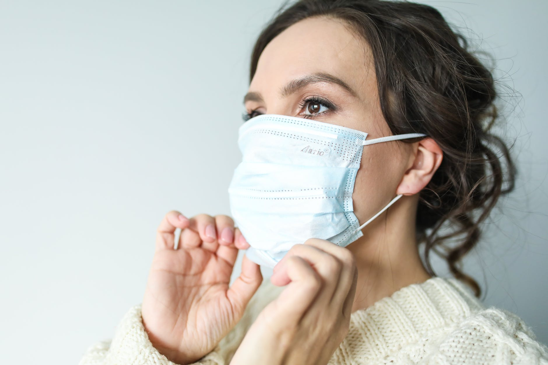 Woman wearing a face mask to prevent the spread of Coronavirus COVID-19