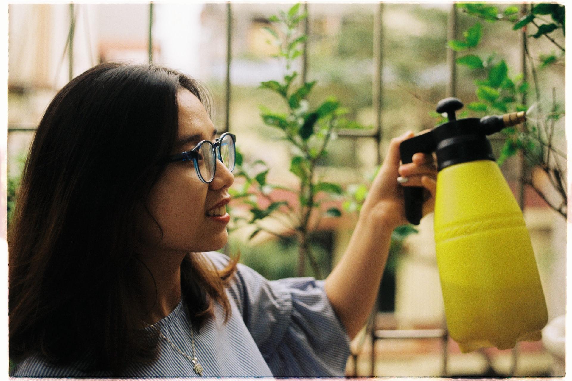 woman holding water sprayer
